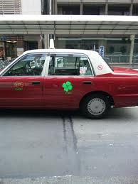 taxi with four leaf clover